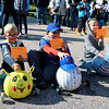 AIMEE AMBROSE | THE GOSHEN NEWS <br /> Drew Pontius, 8, Logan Scholten, 4, and Braxton Lantzer, 5, pose as the first, second and third place winners, respectively, of the second annual Pumpkin Race in Middlebury on Saturday. Pontius raced a Chicago Cubs pumpkin, Scholten's pumpkin was decorated like Pikachu from Pokemon. Lantzer had a shark pumpkin.
