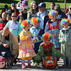 AIMEE AMBROSE | THE GOSHEN NEWS <br /> A group of children dressed as clown ready their clown pumpkin next to a princess pumpkin during the first round of the second annual Pumpkin Race in Middlebury on Saturday.