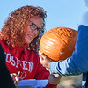 BEN MIKESELL | THE GOSHEN NEWS<br /> Goshen High School engineering teacher Jen Yoder inspects junior Dylan Steury's pumpkin to see if it survived falling from 50 feet during the annual pumpkin drop Thursday morning at Goshen High School.
