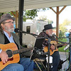 AIMEE AMBROSE | THE GOSHEN NEWS (from left) Steve Seevers and Drew Frailey of Cool Change Band perform folk and mellow classic rock songs during the Syracuse Fall Harvest Festival at Lakeside Park on Saturday.