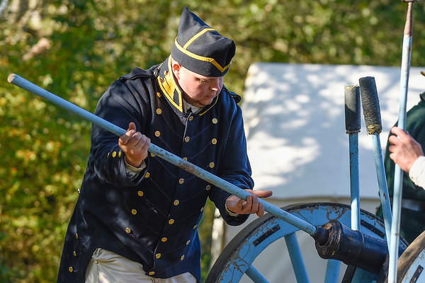 BEN MIKESELL | THE GOSHEN NEWS<br /> Nathan Rentschler, of Roanoke, prepares a cannon during a firing demonstration Saturday morning during the Gathering at the Five Medals in Benton.