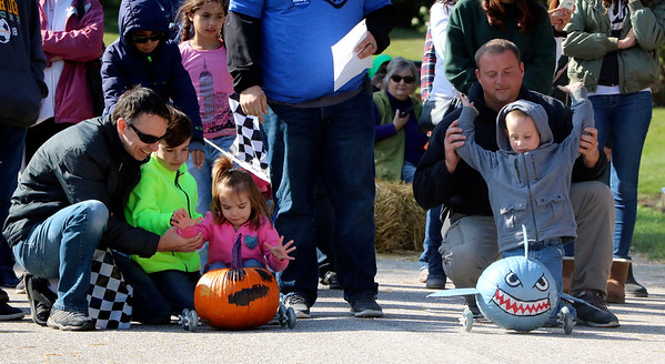 AIMEE AMBROSE | THE GOSHEN NEWS A shark pumpkin and a spooky pumpkin prepare to take off in the second round of the second annual Pumpkin Race in Middlebury on Saturday.