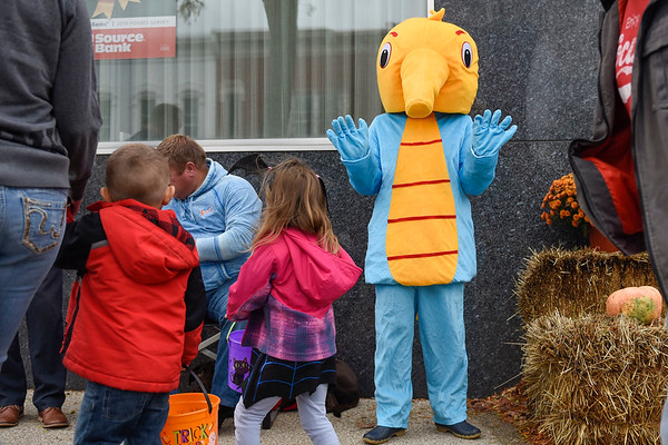 BEN MIKESELL | THE GOSHEN NEWS<br /> Kari Shepard, dressed as Sheppy the Sea Horse, waves to children while trick-or-treating in downtown Goshen Wednesday. Kari and her husband Tony own Shepard Swim School in Elkhart.