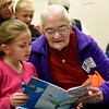BEN MIKESELL | THE GOSHEN NEWS<br /> First-grader Kaitlyn Walker reads a book with Patricia Weaver during the Grandparent's Day celebration Tuesday at Wakarusa Elementary School.