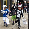 BEN MIKESELL | THE GOSHEN NEWS<br /> Trayce Stewart, 5, left, and Chance Medina, 5, right, lead the way down Main Street while trick-or-treating with their First United Methodist preschool class in downtown Goshen Wednesday.