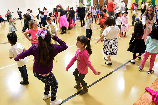 BEN MIKESELL | THE GOSHEN NEWS<br /> First-graders at Concord West Side Elementary School dance in the gym during the 1950s sock hop to celebrate the 50th day of school Monday.