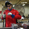 BEN MIKESELL | THE GOSHEN NEWS<br /> Welding artist David Huisman works at his job Thursday at Bennington Marine in Elkhart.