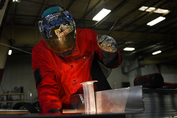 BEN MIKESELL | THE GOSHEN NEWS<br /> Artist David Huisman welds metals Thursday at Bennington Marine in Elkhart.