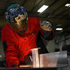 BEN MIKESELL | THE GOSHEN NEWS<br /> Artist David Huisman welds metals Thursday at Bennington Marine in Elkhart.
