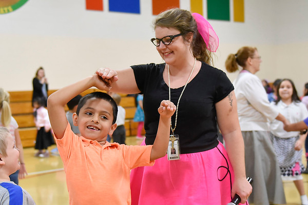 BEN MIKESELL | THE GOSHEN NEWS<br /> Music teacher Christa Jones spins first-grader Isaac Serrato during the 1950s sock hop Monday to celebrate the 50th day of school at Concord West Side.