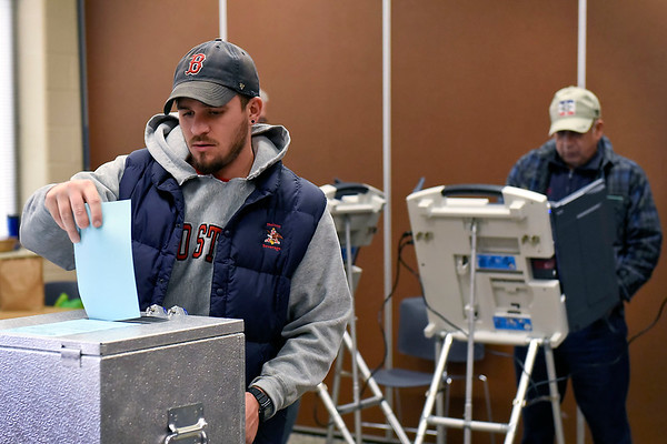BEN MIKESELL | THE GOSHEN NEWS<br /> Goshen resident Clay Norris casts his ballot while early voting Friday afternoon at the Elkhart County Administration Building in Goshen.