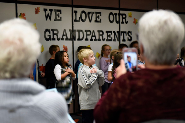 BEN MIKESELL | THE GOSHEN NEWS<br /> Oliver Spitzley, first-grader at Wakarusa Elementary School, sings with his classmates during Grandparent's Day Tuesday afternoon in Wakarusa. The students prepared songs and crafts for their visiting grandparents.