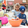 BEN MIKESELL | THE GOSHEN NEWS<br /> Bronson Hurst, 3, dressed as Captain America, picks out candy with LeAnna Taylor, 5, both of Millersburg, while trick-or-treating in downtown Goshen Wednesday.