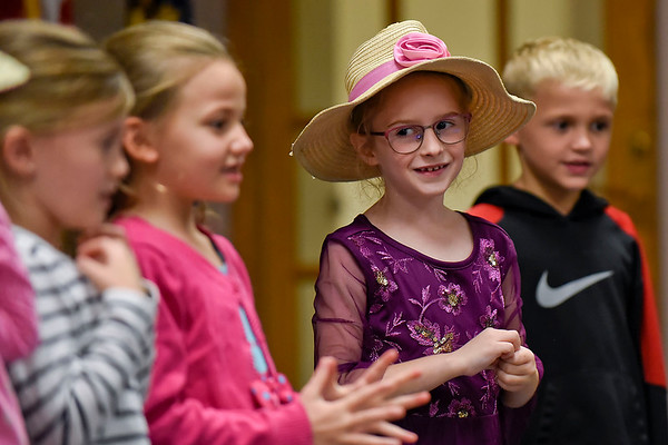 BEN MIKESELL | THE GOSHEN NEWS<br /> First-grader Madilyn Overholser sings with her classmates during their Grandparent's Day celebration Tuesday at Wakarusa Elementary School.