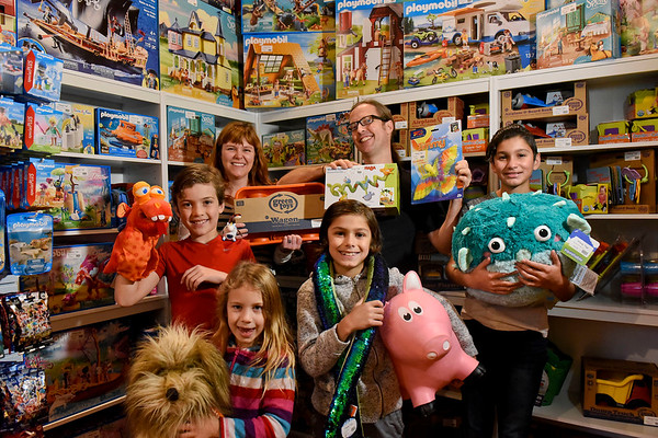 BEN MIKESELL | THE GOSHEN NEWS<br /> Megan Paul and Tim Hochstetler, with their children, from left, Makai, 10, Stella, 6, Malachi, 9, and Kaden 13, inside their new store, Mimsy Toys, located at 123 S Main Street in downtown Goshen.