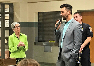 JOHN KLINE   THE GOSHEN NEWS Goshen Mayor Jeremy Stutsman speaks about a planned collaboration between the Goshen Police Department and Goshen Community Schools aimed at improving police response time to school emergencies during a Goshen School Board meeting at Model Elementary School Monday evening.