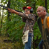 BEN MIKESELL | THE GOSHEN NEWS<br /> Micah Lehman, 12, of Millersburg lines up his shot while instructor Harold Schmucker watches from behind Saturday morning at the Nappanee Conservation Club.