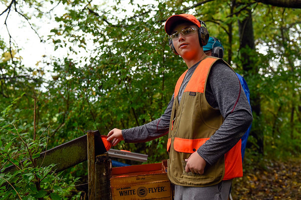 BEN MIKESELL | THE GOSHEN NEWS<br /> Wesley Steiner, 14, of Wawasee, waits for the signal to send a skeet target down a chute Saturday morning at the Nappanee Conservation Club.