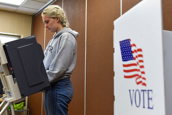 BEN MIKESELL | THE GOSHEN NEWS<br /> Notre Dame student Hanna Zook of Middlebury casts her absentee vote Friday afternoon at the Elkhart County Administration Building in Goshen. Since absentee voting opened Wednesday, more than 400 people have voted in the upcoming midterm election.