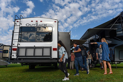 BEN MIKESELL   THE GOSHEN NEWS Katherine Christofferson, school counselor at Goshen Middle School, right, directs eighth-graders as they tour the three RVs on the school grounds Tuesday morning.