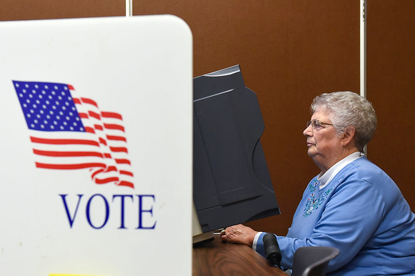 BEN MIKESELL | THE GOSHEN NEWS<br /> Juanita Laidig of Goshen casts her absentee vote Friday afternoon at the Elkhart County Administration Building in Goshen. Since absentee voting opened Wednesday, more than 400 people have voted in the upcoming midterm election.
