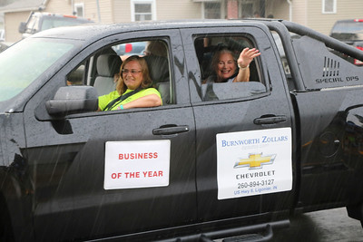 JOHN KLINE | THE GOSHEN NEWS Renee Gabet, owner of Annie Oakley Natural Perfumery, the Ligonier Chamber of Commerce's 2018 Business of the Year, waves to spectators during the 2018 Ligonier Marshmallow Festival Grand Parade Monday afternoon.