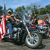 GEOFF LESAR | THE GOSHEN NEWS<br /> <br /> Floyd Davis, a veteran from Jackson, Mich., sits atop his Harley-Davidson motorcycle during a Patriot Tour stop Tuesday afternoon at Hoosier Harley-Davidson in Elkhart. Davis escorted the American flag from Cement City, Mich.
