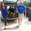 BEN MIKESELL | THE GOSHEN NEWS<br /> Seed to Feed Coordinator Morgan Short, left, and Creekside Church of the Brethren member Ron Green carry a crate of produce into the food pantry at Church Community Services Tuesday in Elkhart. The Seed to Feed program received its 1 millionth pound of produce Tuesday, a goal members have been trying to reach since the program's inception in 2011.