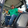 GEOFF LESAR | THE GOSHEN NEWS<br /> <br /> Glenn Geiser, of Goshen, sits inside a Deutz-Fahr Agrofarm 420 tractor Sept. 15 at the Nappanee Apple Festival. Geiser, Lisa Geiser and Josh Stark, all of Goshen, operate Hayrides of St. Jude, a donation-based service supporting the St. Jude Children's Research Hospital.