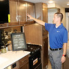 JOHN KLINE | THE GOSHEN NEWS<br /> Sam Jefson, public relations specialist at Winnebago, shows off the company's new Class C RV, the Vita, while at the company's C.R. 15 facility during opening day of the 2018 Elkhart RV Open House Monday morning.