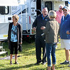 JOHN KLINE | THE GOSHEN NEWS<br /> Gary Conley, national sales manager at Lance Camper, center, chats with Shelby Walsh, a dealer with Hayden's Recreational Vehicles out of Richmond, Virginia, on the campus of the RV/MH Hall of Fame during opening day of the 2018 Elkhart RV Open House Monday morning.