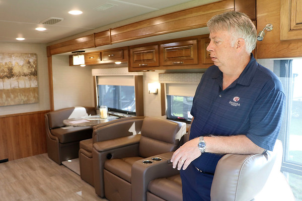 JOHN KLINE | THE GOSHEN NEWS<br /> Brian LaPray, national sales manager at Entegra Coach, gives a tour of the company's new Reatta 39T2 entry level diesel RV while on the campus of the RV/MH Hall of Fame during opening day of the 2018 Elkhart RV Open House Monday morning.