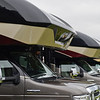 BEN MIKESELL | THE GOSHEN NEWS<br /> Entegra Coach RVs are lined up during the RV Open House Monday at the RV/MH Hall of Fame in Elkhart.