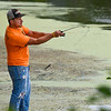 BEN MIKESELL | THE GOSHEN NEWS<br /> Goshen resident Ryan Senders casts his line while fishing off the dock Thursday afternoon at the Goshen Dam Pond.
