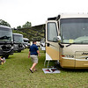 BEN MIKESELL | THE GOSHEN NEWS<br /> People tour Jayco RVs as they are lined up during the RV Open House Monday at the RV/MH Hall of Fame in Elkhart.