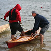 SHEILA SELMAN | THE GOSHEN NEWS<br /> At Fidler Pond Saturday, Jay Burt, right, helps one of the boys from Bashor Children's Home into a kayak the boy helped build.
