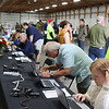 AIMEE AMBROSE | THE GOSHEN NEWS Attendees use to browse and bid on items in the silent online auction during the Michiana Mennonite Relief Sale at the Elkhart County Fairgrounds Saturday. The laptops were setup for public use in the building where auction items were displayed.