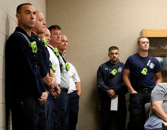 GEOFF LESAR | THE GOSHEN NEWS<br /> <br /> Members of the Goshen Fire Department gather to witness the promotion of Private First Class Winston C. Lechlitner prior to a Monday meeting of the Goshen Board of Works.