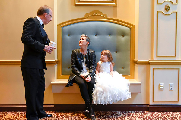 BEN MIKESELL | THE GOSHEN NEWS<br /> Julie Stammich, of Elkhart, center, sits with her niece Everleigh Clark, 5, as they listen to Peter Norton, executive director at Cancer Resources for Elkhart County, before the organization's 10th annual Fashion Show and Luncheon Wednesday at the Lerner Theatre in Elkhart. Both Stammich and Clark walked down the runway during the show to help raise money for Cancer Resources.