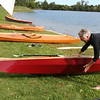 SHEILA SELMAN | THE GOSHEN NEWS<br /> Guy Ellis explains that the details of the kayaks young men at Bashor Children's Home made over the past six months.