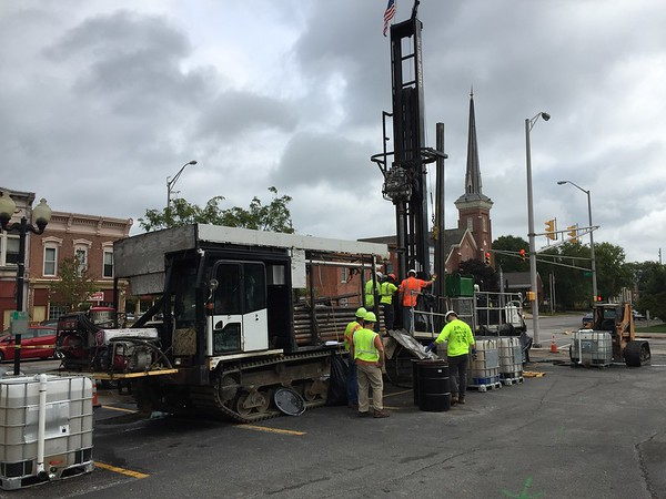 Roger Schneider | The Goshen News<br /> A drilling crew takes soil samples in a Goshen municipal parking lot at Lincoln Avenue and Fifth Street Monday. The samples will be used to help track the source of contaminated groundwater.