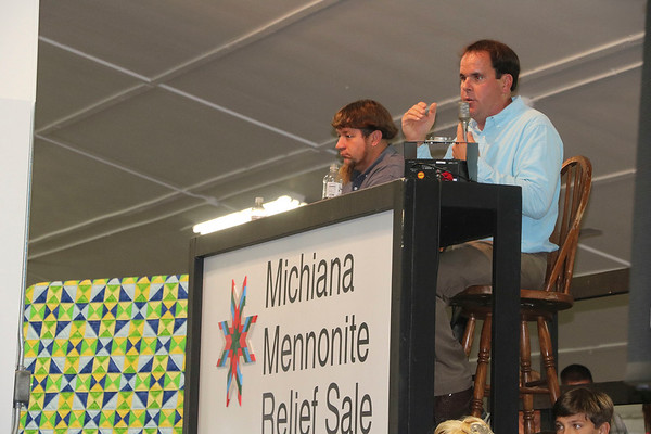 AIMEE AMBROSE   THE GOSHEN NEWS <br /> Auctioneer John Troyer powers through his fast-paced chant to sell a quilt at the quilt auction during the Michiana Mennonite Relief Sale at the Elkhart County Fairgrounds Saturday.