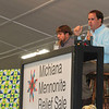 AIMEE AMBROSE | THE GOSHEN NEWS <br /> Auctioneer John Troyer powers through his fast-paced chant to sell a quilt at the quilt auction during the Michiana Mennonite Relief Sale at the Elkhart County Fairgrounds Saturday.