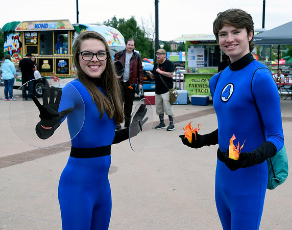 Christina Clark | The Goshen News<br /> Hannah Bever, as Sue Storm, and Michael Hettlinger, as Johnny Storm, of Buchanan, Michian, take in the Hall of Heroes Comic Con Saturday.
