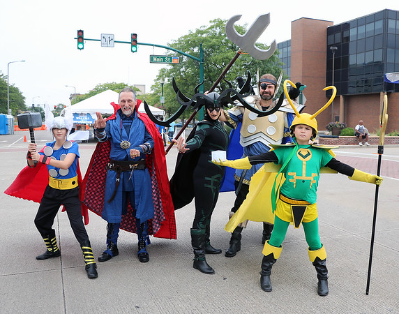 ROGER SCHNEIDER | The Goshen News<br /> A common site on Main Street in Elkhart Saturday and Sunday were people dressed as their favorite character from movies, comic books, video games and other media. Posing from left are Frank Billingsley, 12, as Thor, Dennis Wise as Dr. Strange, Tricia Billingsley as Hela, Godess of Death, Sherman Billingsley as Odin and Sam Billingsley, 10, as Loki. Wise is from Elkhart and the Billingsleys are from LaGrange.