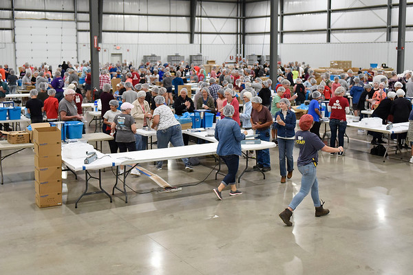 BEN MIKESELL | THE GOSHEN NEWS<br /> Nearly 230 students from Lakeland Middle School were helping the Feed My Starving Children organization with packaging meals Monday afternoon at the Michiana Event Center in Shipshewana. The organization will be making meals in 15 shifts across 6 days, with the goal of making 1 million servings by Saturday.