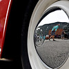 BEN MIKESELL | THE GOSHEN NEWS<br /> Crowds peruse past Volkswagen cars lined up along Washington Street Friday evening for this year's VolksFest in downtown Goshen.