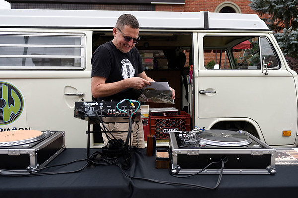 BEN MIKESELL | THE GOSHEN NEWS Jerry Peters, Goshen, puts a record on while manning the Vinyl Wagon Friday evening during VolksFest along Washington Street in downtown Goshen.
