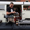 BEN MIKESELL | THE GOSHEN NEWS<br /> Jerry Peters, Goshen, puts a record on while manning the Vinyl Wagon Friday evening during VolksFest along Washington Street in downtown Goshen.