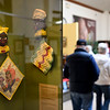 BEN MIKESELL | THE GOSHEN NEWS<br /> People walk through the Sorting Out Race exhibit on display Saturday morning at the Depot Mennonite Central Committee Thrift Shop in Goshen.